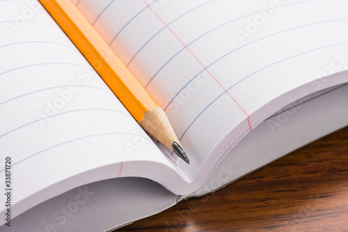 Closeup of pencil laying on notebook