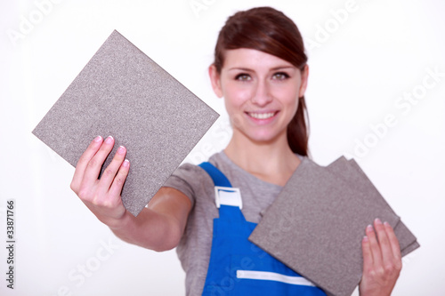portrait of a woman holding tiles