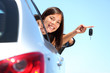 Driver woman showing new car keys