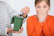 Closeup of a boy putting a battery in a miniature bin - 33871935