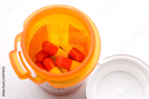 Prescription drug in pill bottle with cap on the side