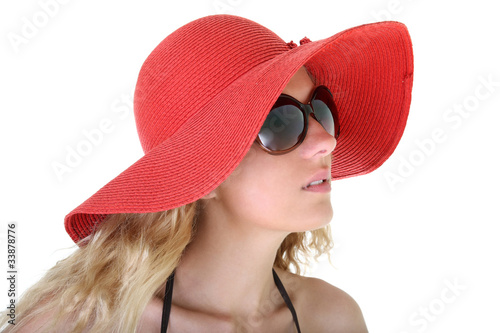 woman in red hat and sunglasses