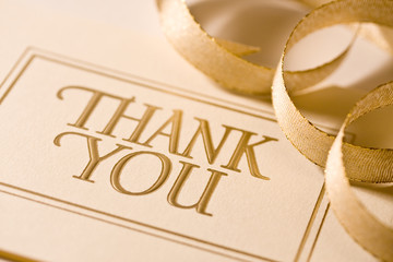 Closeup of thank you card with ribbon