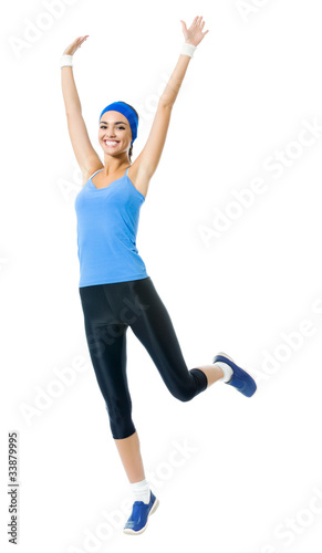 Full body of smiling woman doing fitness exercise, isolated