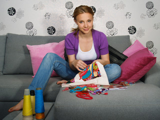 beautiful girl in apartment embroiders