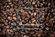 a coffee cup graphic drawing on coffee beans wallpaper.