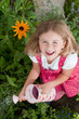 Herbal garden - little girl watering plants