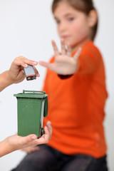 Kids illustrating improper disposal of batteries