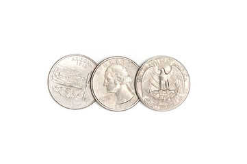 Three American quarters.