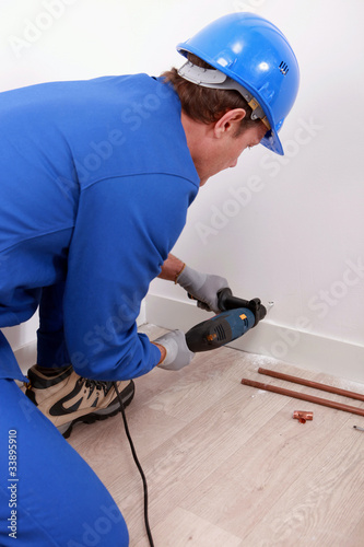 worker drilling wall