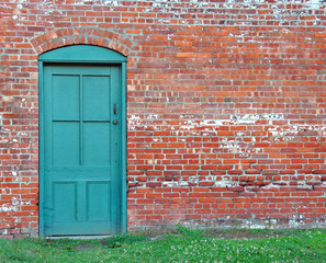 Rustic Green Door in old brick wall.