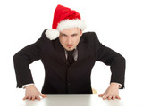 angry, furious  businessman in red Christmas hat