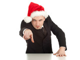 pointing you furious businessman in red Christmas hat