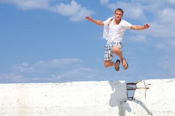 Man Jumping Over Wall