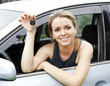 Beautiful young happy woman in car showing the keys