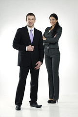 confident smiling businessman and businesswoman