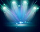 magická reflektory s modré paprsky a zářící efekt
