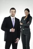 confident businessman and businesswoman