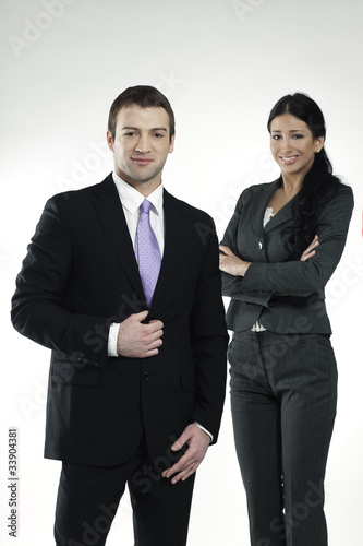 confident businessman and businesswoman