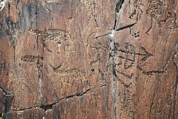 petroglyph of hunters in Kazakhstan