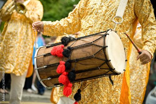 Leinwanddruck Bild musician playing a tradition asian dhol drum