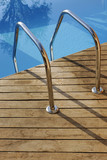 Swimming pool handrail with teak wood flooring poster