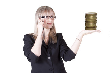 Woman talks on the phone holding coins