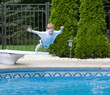 Boy jumping into pool