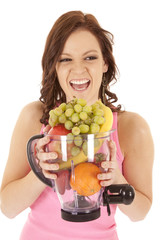 woman fruit blender laugh