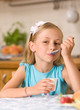 girl eating yoghurt