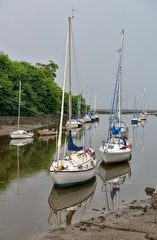 Boats moored at mouth of River Almond, Cramond, Scotland, UK