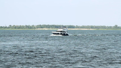 Motor yacht at the river
