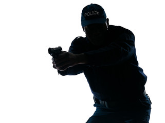 Policeman aiming a handgun