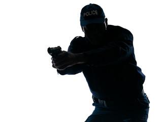 Policeman aiming a handgun