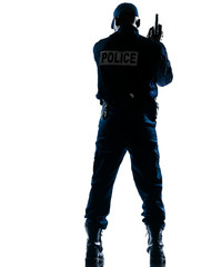 Rear view of policeman with handgun