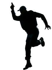 Policeman running with a handgun