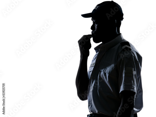Policeman blowing whistle