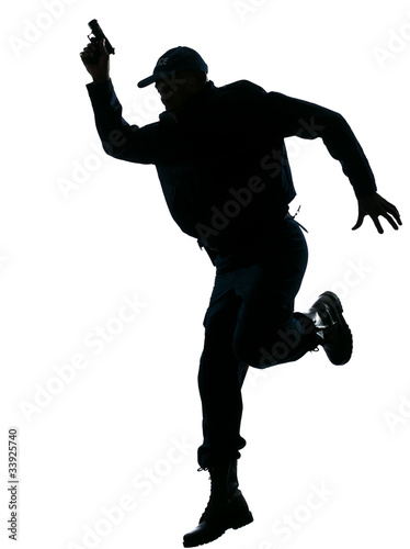 Policeman running with a handgun