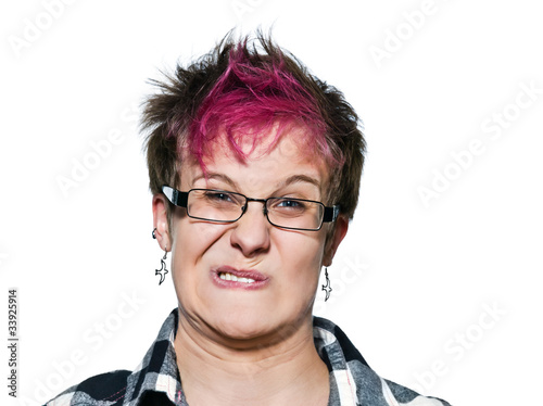 Close-up of an irritated woman making a face