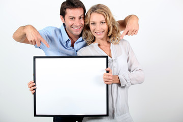 couple holding a frame