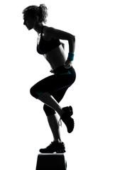 woman exercising step aerobics.