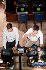 men playing the slot machine