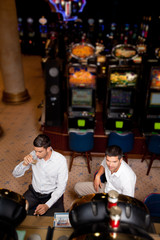 men playing the slot machine