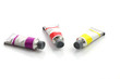 colorful paints tubes isolated in white background