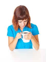 a smiling girl is drinking a coffee