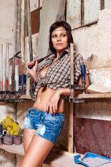 Portrait sexy girl in the carpentry shop carpenters