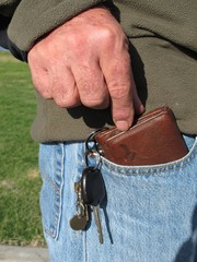 Man taking wallet from jeans pocket  1