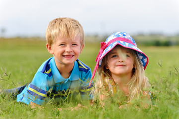 Young blond children in field
