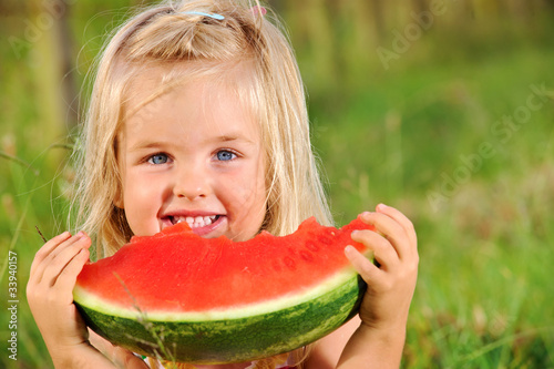 Young girl smiles with watermelon - 33940157