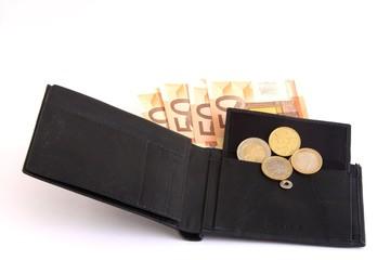 portafogli di pelle nero e denaro